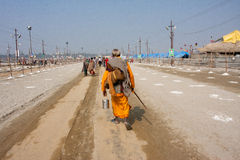 Hindu worshiper rushing to Sangam Royalty Free Stock Photo