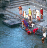 Hindu worshippers come down to bathing ghats Stock Photos
