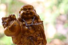 Hinduisk gud Kubera med pengarpåsen i hand arkivbild