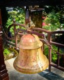 In Hinduism, bells are generally hung at the temple dome in front of the Garbhagriha. Generally, devotees ring the bell while ente. Ring into the sanctum. It is Stock Images