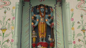 Hinduism gods statue on temple wall in Varanasi