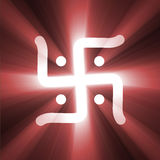 Hinduism swastika sign of success light flare. A Hinduism version of Swastika, an ancient symbol of future success, auspicious, good fortune and luck. A symbolic Stock Photo