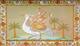 Hinduist god riding a bird on indian painting. This fresco is out of Jodhpur castle, India. It represents an hinduist god riding a strange big bird Stock Photo
