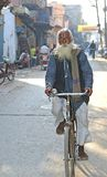 Hinduist man by bicycle Royalty Free Stock Image