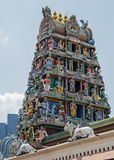 Hinduistic temple in Singapore. Beautiful roof of the temple with lots of god figures Stock Photo