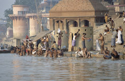 Varanasi, India, Hindus bathing in River Ganges. Bathers along banks of River Ganges in Varanasi, India on sunny day royalty free stock photo