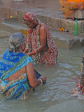 Hindus perform ritual puja at dawn in the Ganges Royalty Free Stock Photo