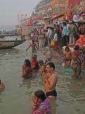 Hindus perform ritual puja at dawn in the Ganges Royalty Free Stock Photography