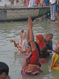 Hindus perform ritual puja at dawn in the Ganges Royalty Free Stock Images