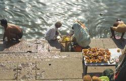 Hindus at Varanasi. Hindu Pilgrims preparing offerings on the Ghtas at Varanasi, India Royalty Free Stock Photo