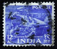 Hindustan aircraft factory,  Five Year Plan - 1st Issue 1955-58, circa 1955. MOSCOW, RUSSIA - APRIL 2, 2017: A post stamp printed in India shows Hindustan Royalty Free Stock Image