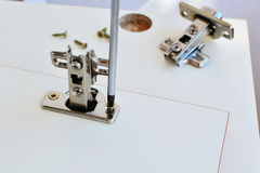 Hinge assembly on kitchen cabinet door Royalty Free Stock Image