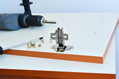 Hinge assembly on kitchen cabinet door Stock Photography