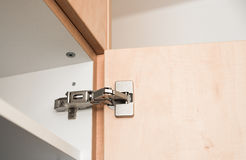 Hinge in a cabinet Royalty Free Stock Image