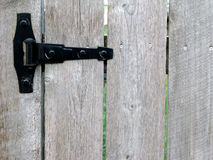 Hinge of Garden Gate. Wood garden gate with black hinge stock image