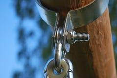 Hinge. Hanger to the swings, toys for children, garden swing for children, wooden swing royalty free stock photography