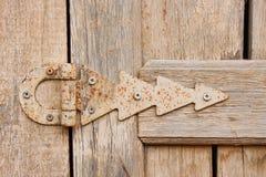 Hinge on an old wooden door Stock Image