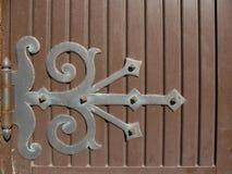Hinge on wooden door Stock Images