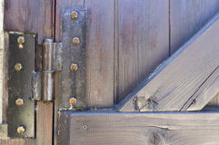 Hinge on wooden door. Stock Image