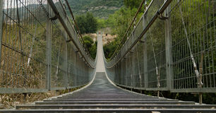 Hinged bridge in Nesher. Israel. Photo was taken in the afternoon on a sunny day in a park in Nesher, Israel. The park has two large hinged bridge over the abyss royalty free stock image