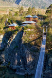 Hinged bridge to the monastery on Patmos island on river Katun i Royalty Free Stock Photo