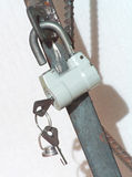 The hinged lock. Hangs on a door Stock Photos