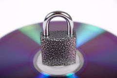 The hinged lock on compact disk Stock Photos