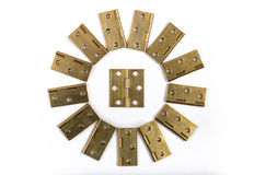 Hinges for doors flower sun circle. Golden brass. On white. Hinges for doors. Golden brass. Isolated on white. The hinges are positioned in the shape of flower Stock Photos