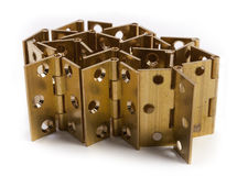 Hinges for doors. Golden brass. On white Royalty Free Stock Images