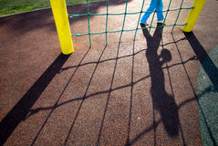 Hinted danger in the playground / school. A child at risk in the playground / school concept Royalty Free Stock Image