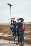 Hinter der Szene Filmteamschmierfilmbildungs-Filmszene im Freien stockfotografie