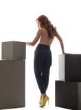 Hintere Ansicht über schulterfreies Mädchen in der hoch-taillierten Hose Stockfotos