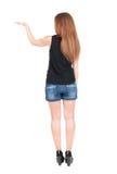 Hintere Ansicht der überraschten schönen jungen Rothaarigefrau mit den Händen Stockfotografie