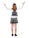 Hintere Ansicht der entsetzten Geschäftsfrau im Kleid stockfoto