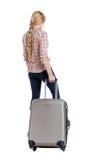 Hintere Ansicht der Frau mit dem Koffer, der oben schaut Stockfotos