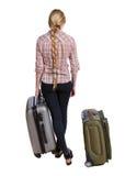 Hintere Ansicht der Frau mit dem Koffer, der oben schaut Stehendes junges Mädchen Lizenzfreie Stockbilder