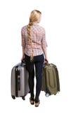 Hintere Ansicht der Frau mit dem Koffer, der oben schaut Stehendes junges Mädchen Lizenzfreie Stockfotos