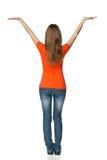 Hintere Ansicht der jungen zufälligen Frau Holdingleerzeichen-Exemplarplatz im in voller Länge Stockfoto