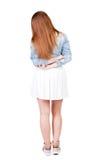 Hintere Ansicht der Stellung der jungen schönen Frau Stockfotos