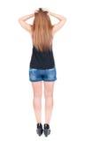 Hintere Ansicht der Stellung der jungen schönen Rothaarigefrau Stockfotografie