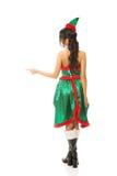 Hintere Ansicht der tragenden Elfe der Frau kleidet das Zeigen nach links Stockfotos