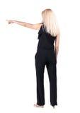 Hintere Ansicht der Zeigefrau schönes blondes gir Lizenzfreie Stockfotos
