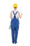 Hintere Ansicht des Frauenerbauers in der Arbeitskleidung, die Bauplan hält, ist Stockfotografie