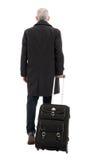 Hintere Ansicht des Geschäftsmannes mit machen Gepäck weiter Stockfotos