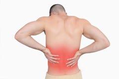 Hintere Ansicht des hemdlosen Mannes mit Rückenschmerzen Lizenzfreies Stockfoto