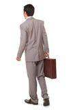 Hintere Ansicht eines Geschäftsmannes, der einen Aktenkoffer steht und hält Stockbild
