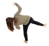 Hintere Ansichtfrau Balancen, die seine Arme wellenartig bewegen Lizenzfreie Stockfotos