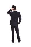 Hintere Haltung eines Geschäftspersonendenkens Lizenzfreie Stockbilder