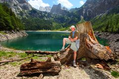 The Hinterer Gosausee (Upper Gosau Lake). Happy traveler on a Hinterer Gosausee (Upper Gosau Lake) against Dachstein peak. Gosau, Salzkammergut, Austria, Europe Stock Image
