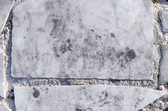 Hintergründe mit grauen Stücken des Steins mit Marmoreffekt Lizenzfreie Stockfotos